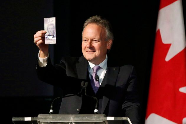 Bank of Canada Governor Stephen Poloz shows off Canada's new $10 banknote at a launch at the Canadian Museum For Human Rights in Winnipeg on Nov. 19, 2018.