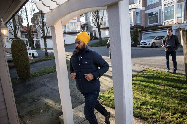 NDP Leader Jagmeet Singh jogs up to a home while door knocking for his byelection campaign, in Burnaby, B.C. on Jan. 12, 2019.
