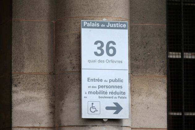 A street sign is seen on the main entrance of the 36, Quai des Orfevres, Paris headquarters of the criminal...