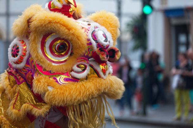 A performer in a traditional lion dance costume for Chinese New Year.