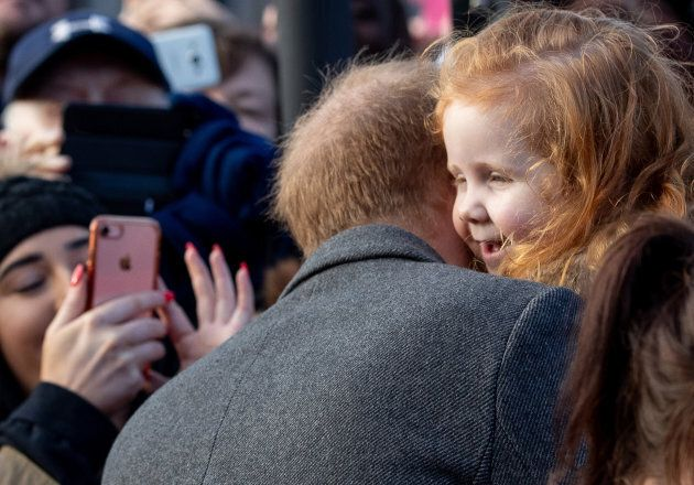 Prince Harry giving Eliza a hug.