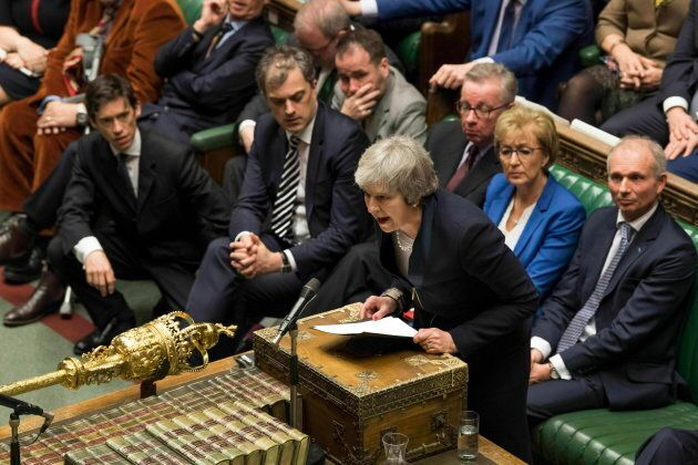 Theresa May speaks in the House of Commons in London after losing a vote on her Brexit plan on Jan. 15,