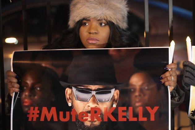 """Demonstrators gather near R. Kelly's to call for a boycott of his music after allegations of sexual abuse against young girls were raised on """"Surviving R. Kelly"""" on Jan. 9."""