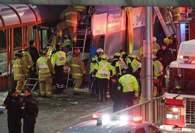 Police and first responders at the scene of the crash in Ottawa, on Jan. 11,