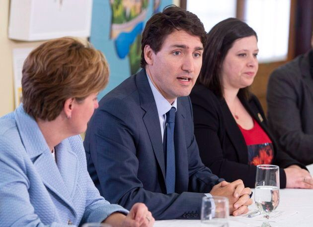 Lac-Mégantic mayor Julie Morin, right, with Prime Minister Justin Trudeau and International Development Minister Marie-Claude Bibeau during a round table on regional development on May 11, 2018 in Lac-Mégantic, Que.