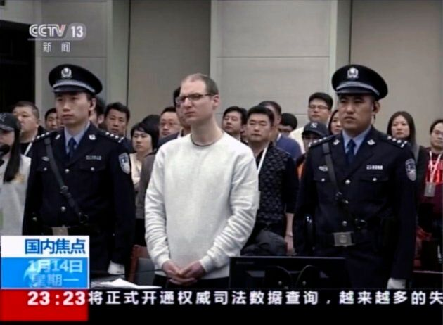 In this image taken from a video footage run by China's CCTV, Canadian Robert Lloyd Schellenberg attends...
