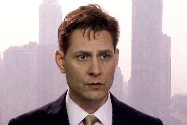 In this file image made from a video taken on March 28, 2018, Canadian Michael Kovrig, an adviser with...