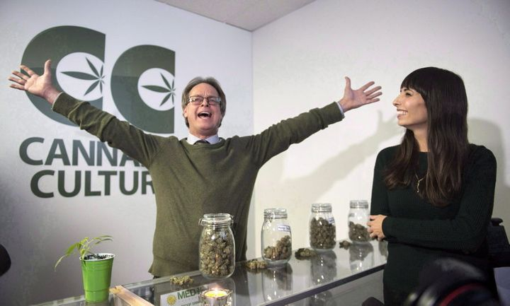Marc Emery, with Jodie Emery at right, gestures at the opening of a Cannabis Culture pot store on Dec. 15, 2016, in Montreal.