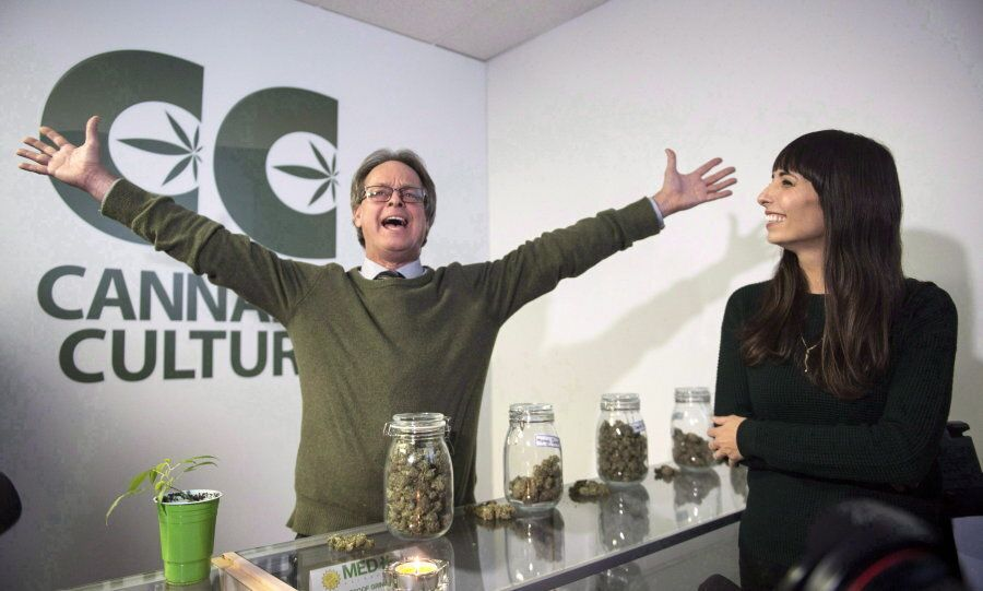 Marc Emery, with Jodie Emery at right, gestures at the opening of a Cannabis Culture pot store on Dec....