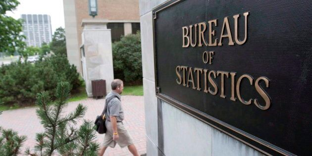 An employee makes their way to work at Statistics Canada, in Ottawa on July 21,
