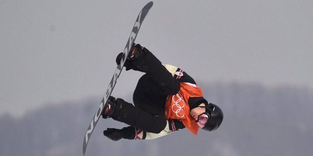Canada's Max Parrot of Bromont, Que. flies through the air during his second run in the men's snowboard...