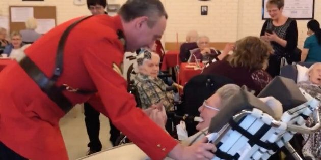 Cpl. Daryl Chernoff takes 100-year-old Elsie Shepherd for a glide around the dance floor at her birthday