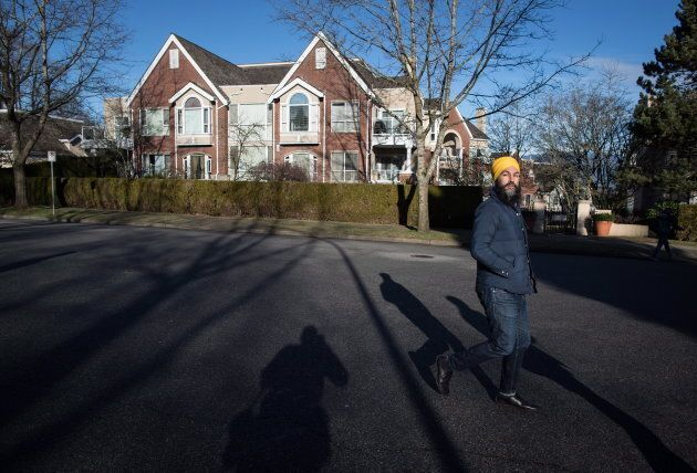 NDP Leader Jagmeet Singh crosses a street while door knocking for his byelection campaign, in Burnaby, B.C. on Jan. 12, 2019.