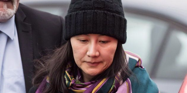 Meng Wanzhou arrives at a parole office with a member of her private security detail in Vancouver on...