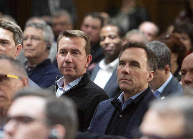Former Treasury Board president Scott Brison sits with Finance Minister Bill Morneau during a Liberal...