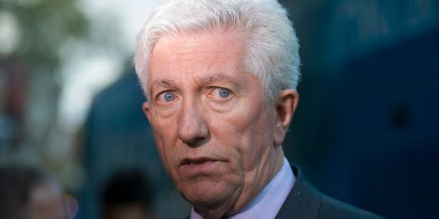 Former Bloc Quebecois leader Gilles Duceppe speaks to reporters during a federal election campaign stop...