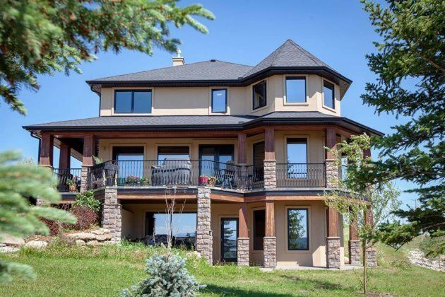 The rural home features a walk-out basement and views of the Canadian
