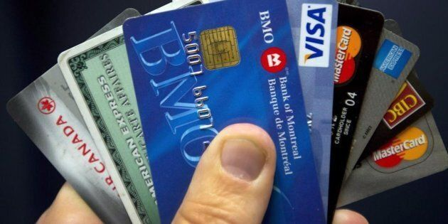 Credit cards are displayed in Montreal, Wed. Dec. 12, 2012. The latest Consumer Debt Index that shows...