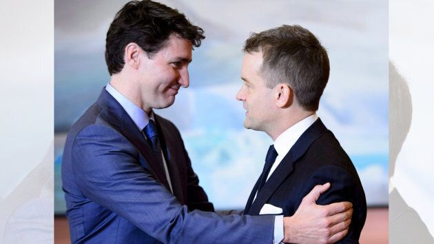 Prime Minister Justin Trudeau embraces Indigenous Services Minister Seamus O'Regan at a swearing in ceremony...