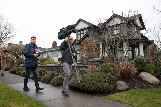 Members of the media wait outside the residence of Huawei Technologies Chief Financial Officer Meng Wanzhou...
