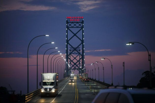 Vehicles drive across Ambassador Bridge on the Canada-U.S. border in Windsor, Ont., on Aug. 9,