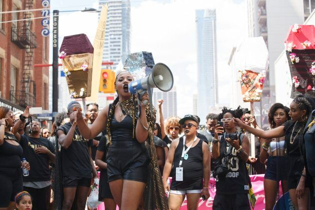Alexandria Williams (front with bullhorn) and members of Black Lives Matter are photographed at the Pride...