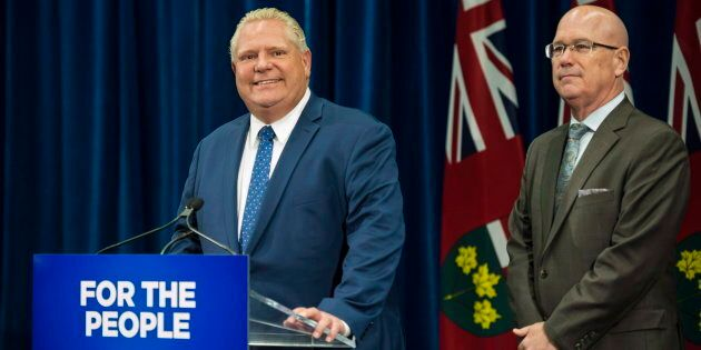 Ontario Premier Doug Ford speaks to reporters with MPP Steve Clark, Minister of Municipal Affairs and...