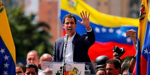 Juan Guaido, head of Venezuela's opposition-run congress, speaks to supporters in Caracas, Venezuela,...