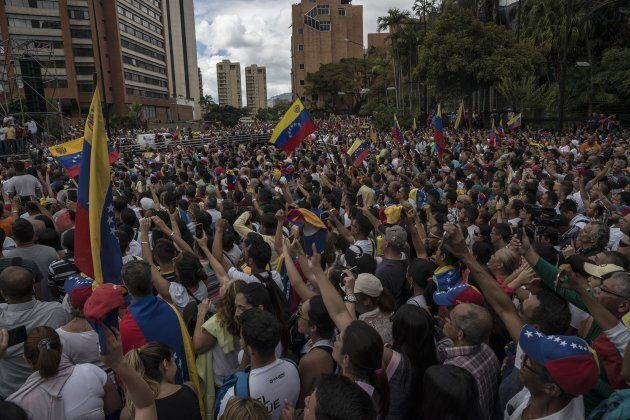 Venezuelans gather for a mass rally against Nicolas Maduro in Caracas, Venezuela on Jan. 23,