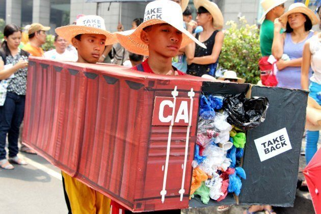 Protesters led by the EcoWaste Coalition and Piglas Kababaihan gather outside the Canadian Embassy in...