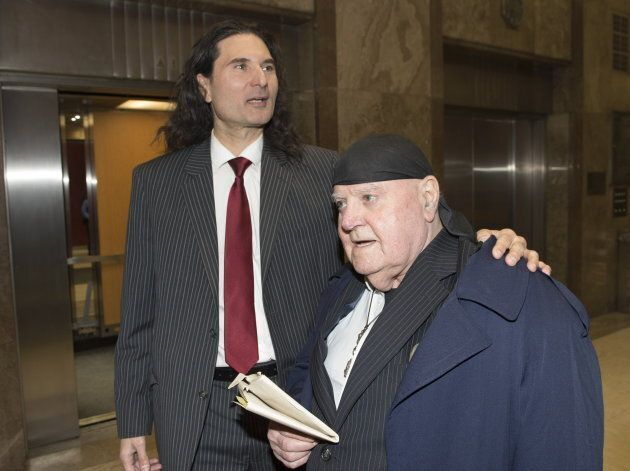 James Sears and LeRoy St. Germaine (right) leave court after being found guilty of promoting hate in...