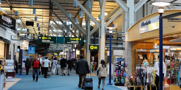 Passengers at Vancouver International Airport, Richmond, B.C. March 11,