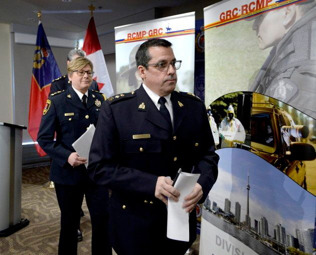 RCMP Supt. Peter Lambertucci and Kingston Police chief Antje McNeely leave a press conference after announcing...