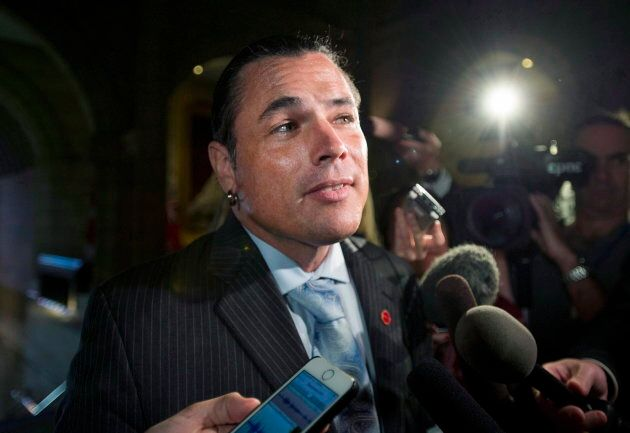 Sen. Patrick Brazeau speaks to reporters as he returns to the Senate on Sept. 27,