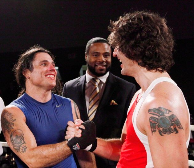 Patrick Brazeau congratulates Justin Trudeau after their charity boxing match for cancer research on March 31, 2012 in Ottawa.