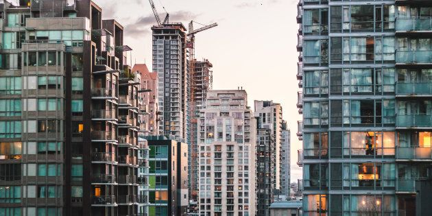 Apartment and condo buildings in downtown Vancouver. Rapid house price growth in many parts of the country means renting has become cheaper than buyingon a national level for the first time in years.