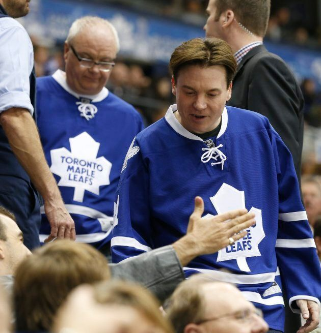 Mike Myers wears a Toronto Maple Leafs jersey to a Toronto vs. Boston hockey game at the Air Canada Centre on Oct. 25, 2014.