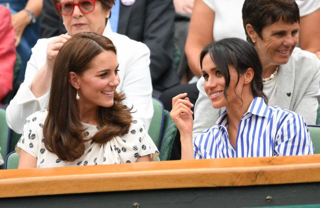 Kate Middleton and Meghan Markle at the Wimbledon Tennis Championships at the All England Lawn Tennis and Croquet Club on July 14, 2018 in London.