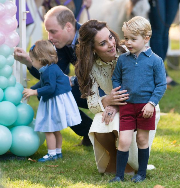 Prince George with his sister Charlotte and his parents, the Duke and Duchess of Cambridge at children's party for military families in Victoria, B.C. on Sept. 29, 2016.