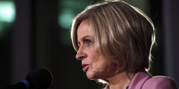 Premier Notley speaks during an announcement of a mandatory cut in oil production, in Edmonton on,Dec....