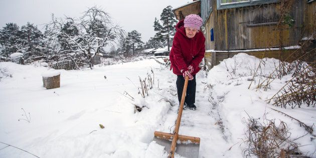A stock photo of an elderly woman clearing