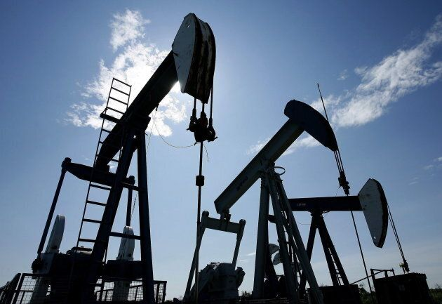 Pumpjacks are shown pumping crude oil near Halkirk, Alta., on June 20,