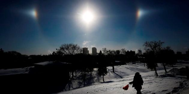 Sun Dogs, formed by the sun reflecting off ice crystals in bitterly cold temperatures, sit over the Winnipeg...
