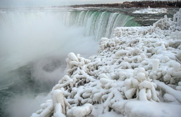 Ice and snow cover branches near the brink of the Horseshoe Falls, due to subzero temperatures in Niagara...