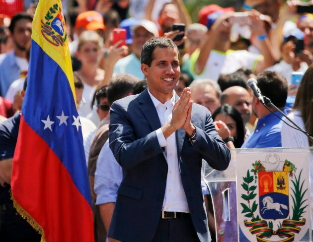 Venezuelan opposition leader Juan Guaido, who has declared himself the interim president of Venezuela, greets supporters as he arrives at a nationwide demonstration demanding the resignation of President Nicolas Maduro, in Caracas, Venezuela on Feb. 2, 2019.