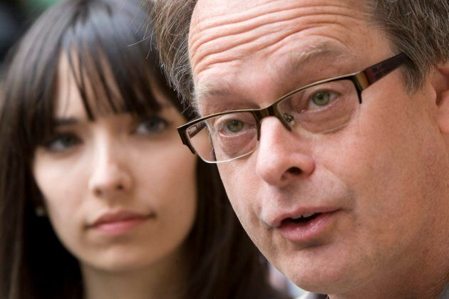 """Marc Emery, the self-described """"Prince of Pot"""" speaks to reporters outside the Supreme Court in Vancouver May 10, 2010, prior to turning himself in to be extradited to the United States as his wife Jodie, left, looks on."""