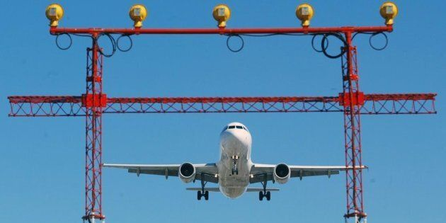 An airplane prepares to land at Pearson International Airport in Toronto, Thursday September 30, 2004....