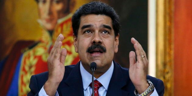 Venezuelan President Nicolas Maduro gives a press conference at Miraflores presidential palace in Caracas...