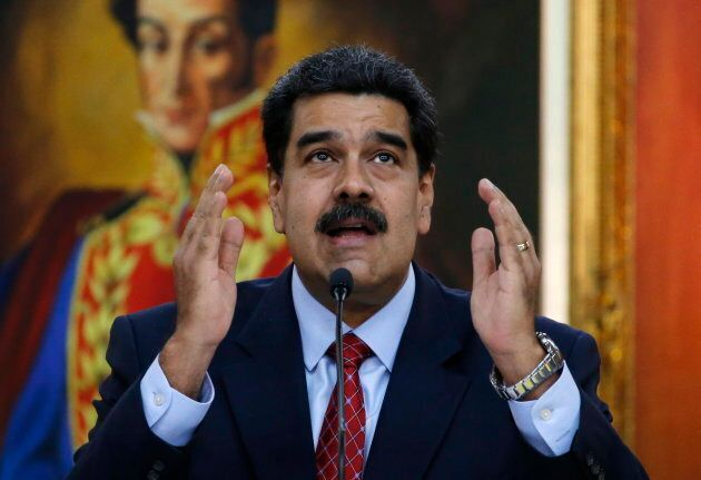 Venezuelan President Nicolas Maduro gives a press conference at Miraflores presidential palace in Caracas...
