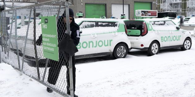A security guard closes the gate of a parking lot of Teo Taxi in Montreal on Jan. 29, 2019. Montreal's...